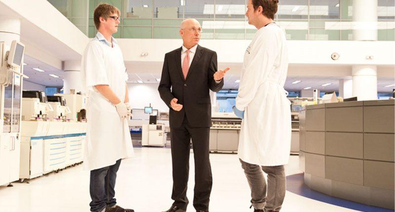 Sonic Healthcare (ASX:SHL) - CEO Dr Colin Goldschmidt (middle)